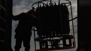 Oceanographic instrument is lowered to collect water samples at different ocean depths